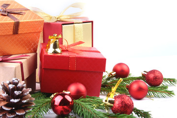 New Year or Christmas decorations with gift boxes, candles and balls. greeting card. Selective focus, copy space.
