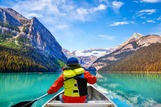 Boy Canoeing on Lake Louise in Banff National Park Canada