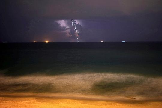 Lightning strikes over the Mediterranean sea during a rain storm near the city of Ashkelon
