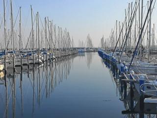 Italy, sailing boats in the Marina of Ravenna harbor.