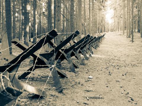Iron anti-tank barrier from World War II. Retro sepia style image.