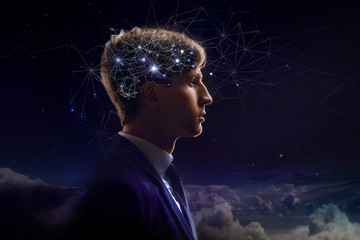 Profile of man with symbol neurons in brain. Thinking like stars, the cosmos inside human