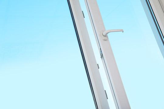 View of blue sky through modern window indoors