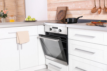 Light modern kitchen interior with new oven