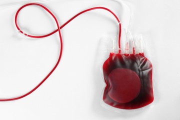 Blood pack for transfusion on white background, top view. Donation day
