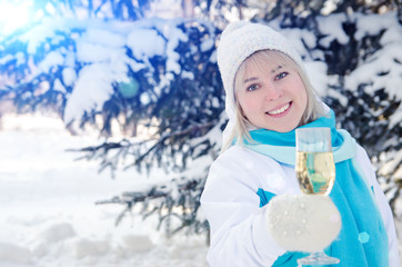 Beautiful attractive blonde with a glass of champagne in her hands celebrates the New Year