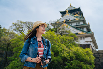 traveler standing in front of osaka palace
