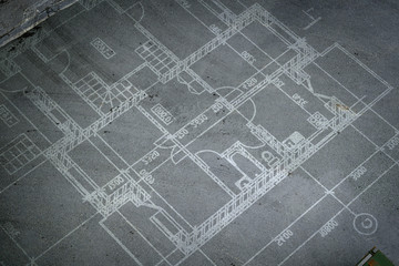 Construction drawings on floor