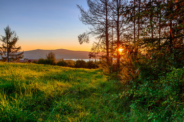 Polanczyk, Bieszczady mountains, Poland - views during sunrise on Solina Lake from hill near Polanczyk town (south-east region in Poland)