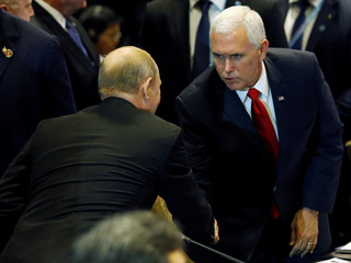 U.S. Vice President Mike Pence shakes hands with Russia's President Vladimir Putin before a group photo with ASEAN leaders at the East Asia Summit in Singapore