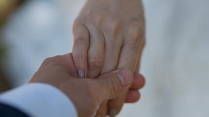 Men's hand held women.