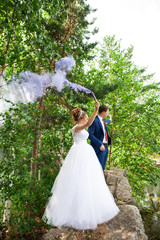 wedding photo shoot with smoke in nature