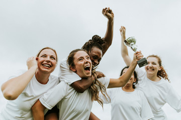 Female football players celebrating their victory