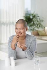 Cancer survivor taking pills