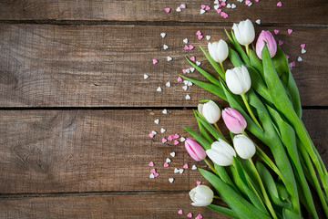 tulips and hearts on wooden surface