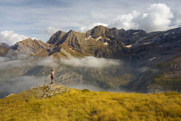 Standing tourist on the ridge with mountains on backround, Pyrenees