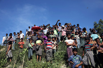 Rohingya refugees gather as hundreds of them protest against the repatriation at the Unchiprang camp in Teknaf
