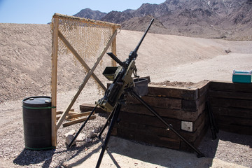 Heavy .50 caliber machine gun on a mount in a shooting range near Las Vegas