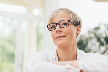 Thoughtful woman wearing glasses
