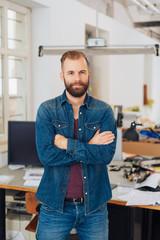 confident businessman in an open plan office