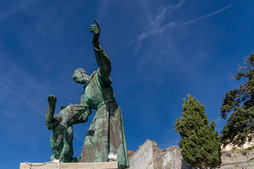The blue sky is the background of St. Francis of Assisi with the dog, Monterosso al mare, Cinque Terre, Liguria, Italy