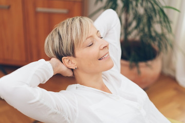 Blissful attractive blond woman relaxing