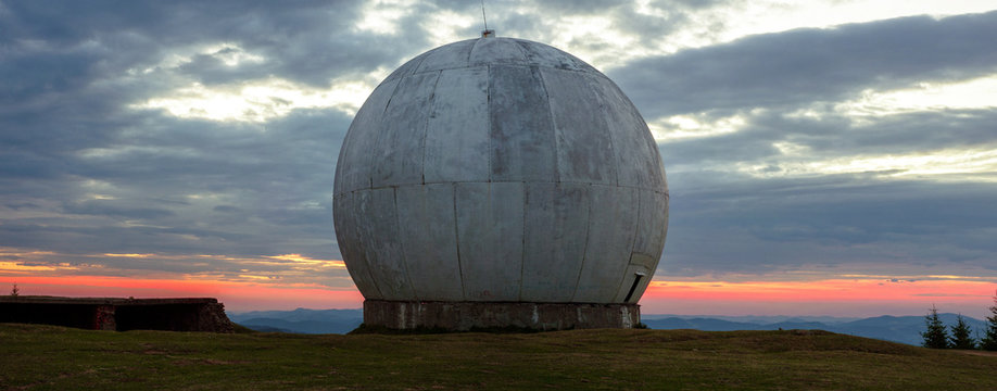 The old military facility is a tracking system. Radar base. Old giant dome of a radar antenna of a Ukrainian military base. Apocalyptic view.
