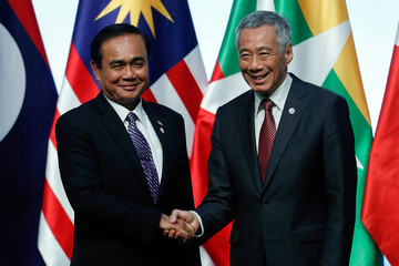 Thailand's Prime Minister Prayuth Chan-ocha shakes hand with Singapore's Prime Minister Lee Hsien Loong during the Closing Ceremony of the ASEAN Summit and Related Summit in Singapore