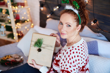 Portrait of girl showing christmas present