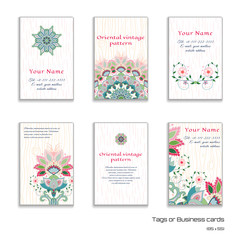 Set of six vertical business cards with indian flowers. Backdrops with strokes and wood. Place for your text.
