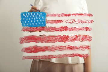 Woman with painting of American national flag on glass