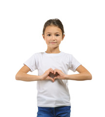 Cute girl in t-shirt making heart with her hands on white background