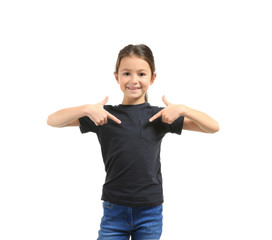 Cute girl pointing at her in t-shirt on white background