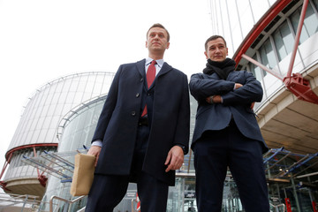 Russian opposition leader Alexei Navalny poses with his brother Oleg after a hearing for the delivery of the European court of Human Rights Grand Chamber judgment regarding his case against Russia at the court in Strasbourg