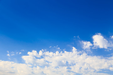 Blue sky with white cumulus clouds. Abstract natural background. Perfect summer day in the countryside.