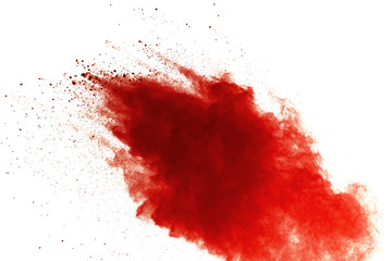 Red powder explosion on white background. Paint Holi.
