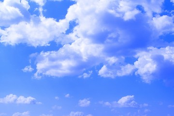 lovely toned cumulus cloudy sky for using in design as background.