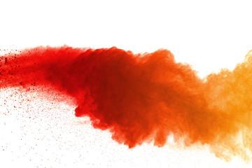 Orange powder explosion on white background. Colored cloud. Colorful dust explode. Paint Holi.