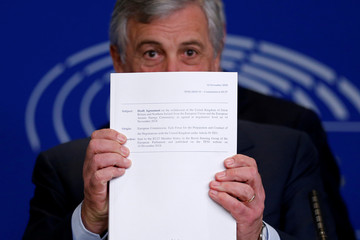European Parliament President Antonio Tajani displays withdrawal agreement at a news conference about Brexit at the European Parliament in Strasbourg