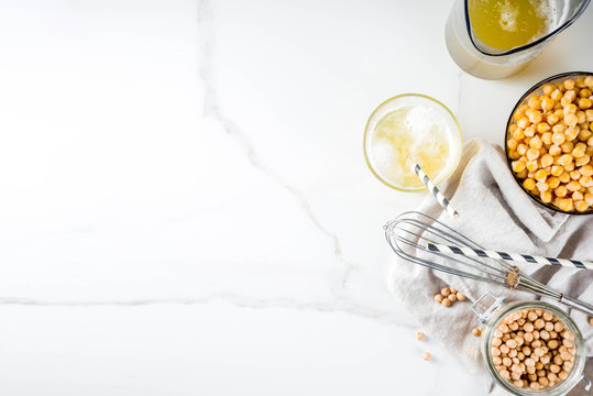 Chickpea broth aquafaba, liquid water brine, Replace egg in baking for vegan recipe. Vegan diet drink, white marble background copy space