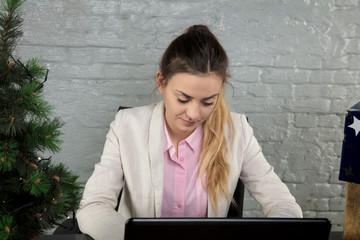 business woman focused on work, Christmas tree on the desk