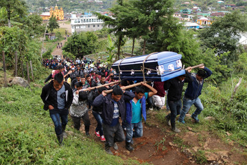 The Wider Image: Deadly crossing ends American dream for Guatemalan migrant