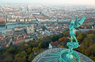 Statue of Saint Michel and the view over Lyon from basilique Notre-Dame de Fourviere, Lyon, France.