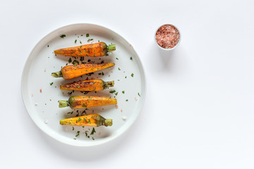 Healthy roasted carrots On white background