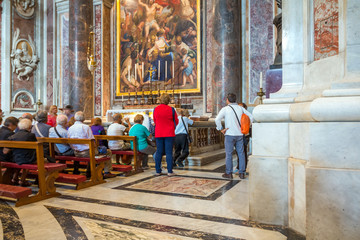 VATICAN, ROME, ITALY - October 4, 2016: Interiors and architectural details of St. Peter Basilica with tourists inside