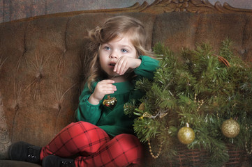 little girl with a Christmas garland
