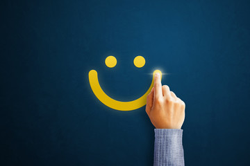 Hand of client show a feedback with smiley face. Service rating, satisfaction concept