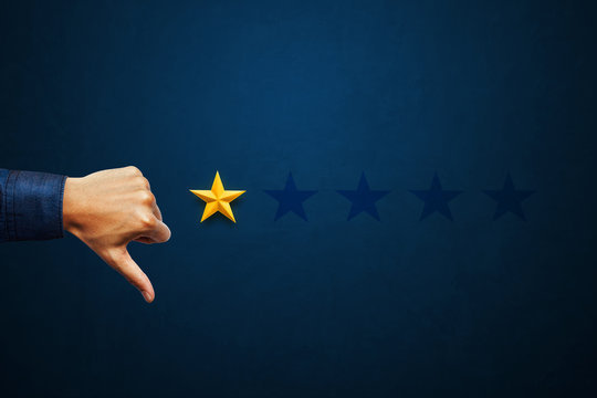 Hand of client show thumb down with one star rating. Service rating, satisfaction concept