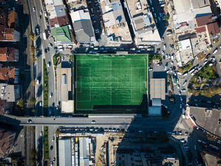 aerial view of a football field in residental area. top view of football pitch