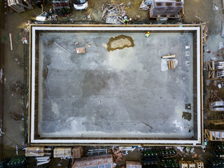Aerial top view of construction worker work on swimmingpool at construction site